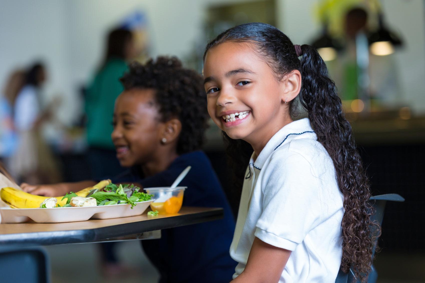 Cute-elementary-school-girl-eating-healthy-lunch-in-cafeteria-000043847850_Medium.jpg